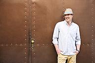 Germany, Bavaria, Mature man looking away, smiling - MAEF006833