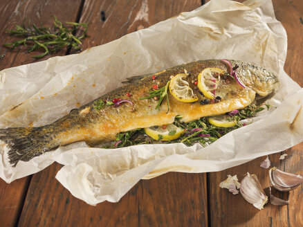 Fried trout stuffed with herbs on wooden plank - CH000026