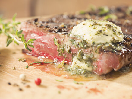 Rump steak with herb butter on wood - CH000034