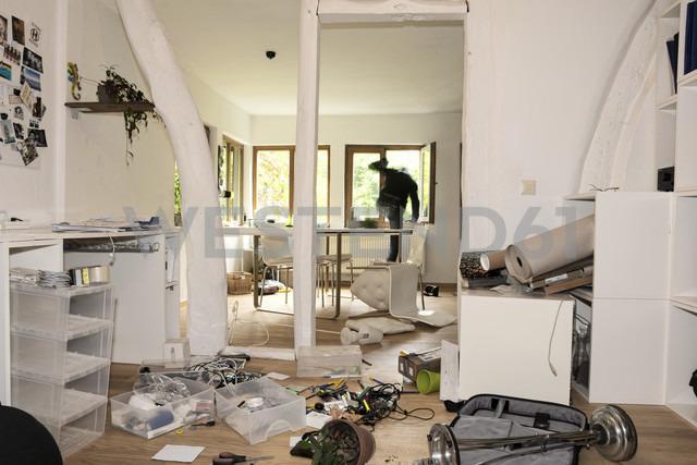 Germany, North Rhine Westphalia, Mature man running through window - ONF000207