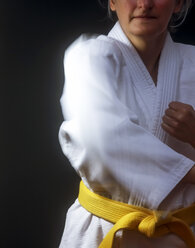 Germany, Saxony, Mature woman doing martial arts, close up - JT000422