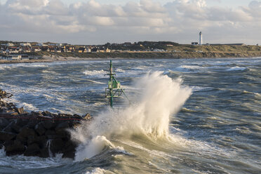 Denmark, View of surf at harbour entrance of town - HWO000052