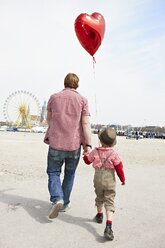 Germany, Bavaria, Munich, Father and son going to Oktoberfest - EDF000024