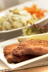 Viennese Schnitzel on plate, close up - OD000059