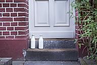 Milk bottle on doorstep - FMKYF000287