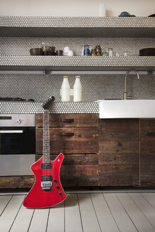 Interior of kitchen with electric guitar - FMKYF000348