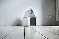 Laptop house on wooden floor - FMKYF000342