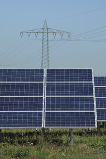 Germany, Bavaria, Solar panels with power pole in background - RDF001034