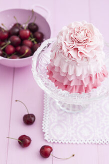 Pink mini cake on cakestand with cherries - ECF000203