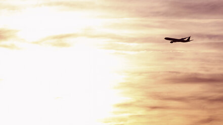 Germany, Bavaria, Munich, View of airbus a 340-600 departing at sunset - RDF001105