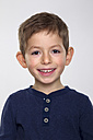 Portrait of boy against white background, smiling - RD001121