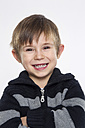Portrait of boy against white background, smiling - RD001136