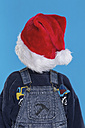 Boy covering face with santa hat - RDF001112