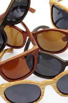 Wooden sunglasses on white background, close up - HOHF000167