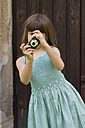 Germany, Baden Wuerttemberg, Girl taking picture with camera - LV000125