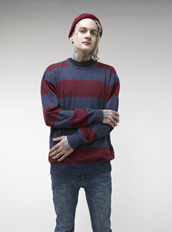 Portrait of young man with tattoos - RH000239