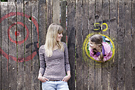 Germany, North Rhine Westphalia, Cologne, Mother and daughter looking at each other, smiling - FMKYF000382