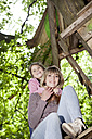 Germany, North Rhine Westphalia, Cologne, Mother and daughter embracing each other, smiling - FMKYF000396