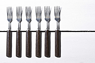Forks on wooden table, close up - MAEF006839