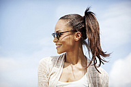 Germany, Young woman with sunglasses, smiling - GDF000095