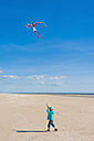 Denmark, Romo, Boy flying kite at North Sea - MJF000229