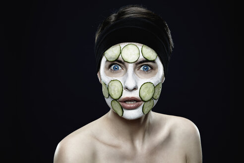 Portrait of young woman with zinc clay mask, close up - SPO000464