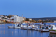 Turkey, Cesme, View of fishing harbour, Cesme castle in background - SIE004000
