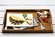 Omelette with mushrooms on wooden table - MAEF006893