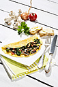 Omelette with mushrooms on wooden table - MAEF006894