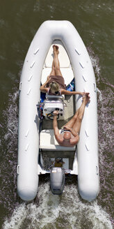 Germany, Mature couple on an excursion by inflatable motorboat - BSC000302
