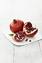 Pomegranates on wooden table, close up - KSWF001157
