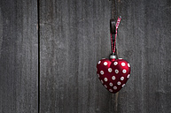 Heart shaped Christmas bauble hanging on door - OD000145