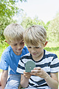 Germany, Bavaria, two boys looking at a compass - NH001376