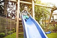 Germany, Bonn, Baby boy playing on slide - MF000534