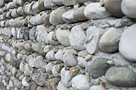 Italy, Construction of house building with pebble stone - CRF002432