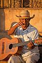 Cuba, Man holding guitar - PC000015