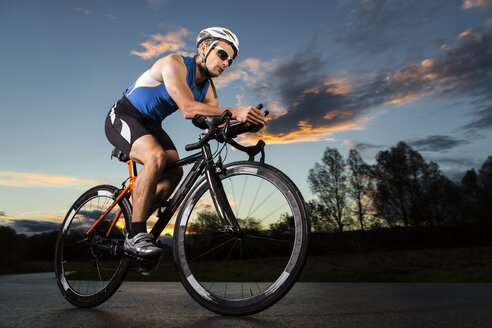 Germany, triathlete riding bicycle - STSF000057