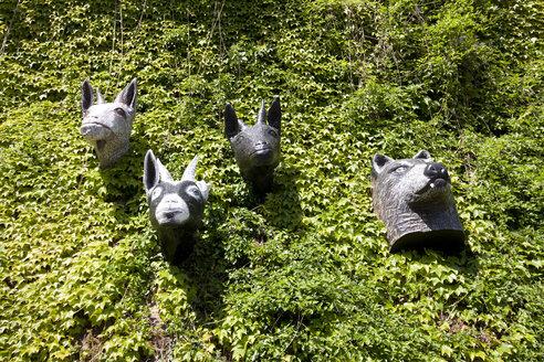 Germany, Hesse, Marburg, Statues of animal head - AM000638
