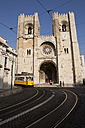 Portugal, Lisbon, Tramway passing by Lisbon Cathedral - SK001323