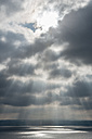Germany, View of breakthrough of sun rays at lake - SH000814