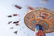Germany, Bavaria, Munich, Carousel spinning on Oktoberfest - SK001351