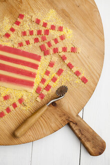 Homemade pasta on chopping board, close up - ECF000240