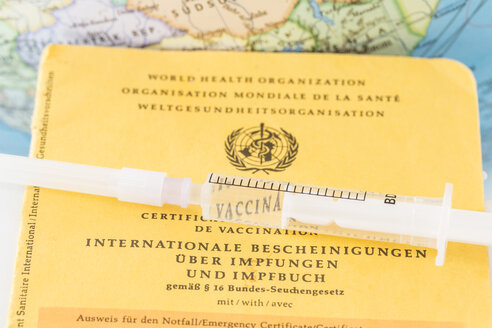 Germany, Freiburg, Syringe on vaccination certificate - DR000021