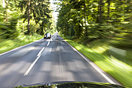 Germany, Baden Wuerttemberg, Car passing through forest - AM000688