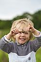 Germany, Kiel, Girl research in nature, smiling - JFEF000146