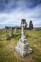 United Kingdom, Scotland, View of old Stonecross with chapel ruin in background - ELF000250