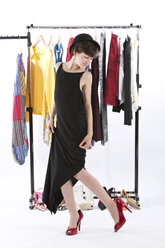 Girl fitting wardrobe of her mother - MAEF006920