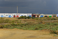 Spain, Andalucia, Huelva, Costa de la Luz, Lepe, dark clouds over the industrial area of the village El Catalan - MIZ000415