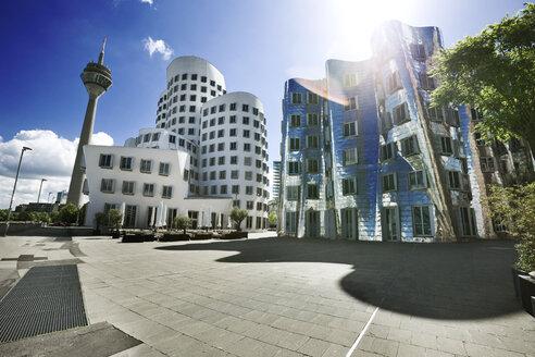 Germany, North Rhine-Westphalia, Dusseldorf, Gehry Buildings and TV tower at Medienhafen - MFF000623