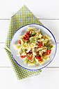 Plate of fennel tomato pasta on wooden table, close up - EVGF000144